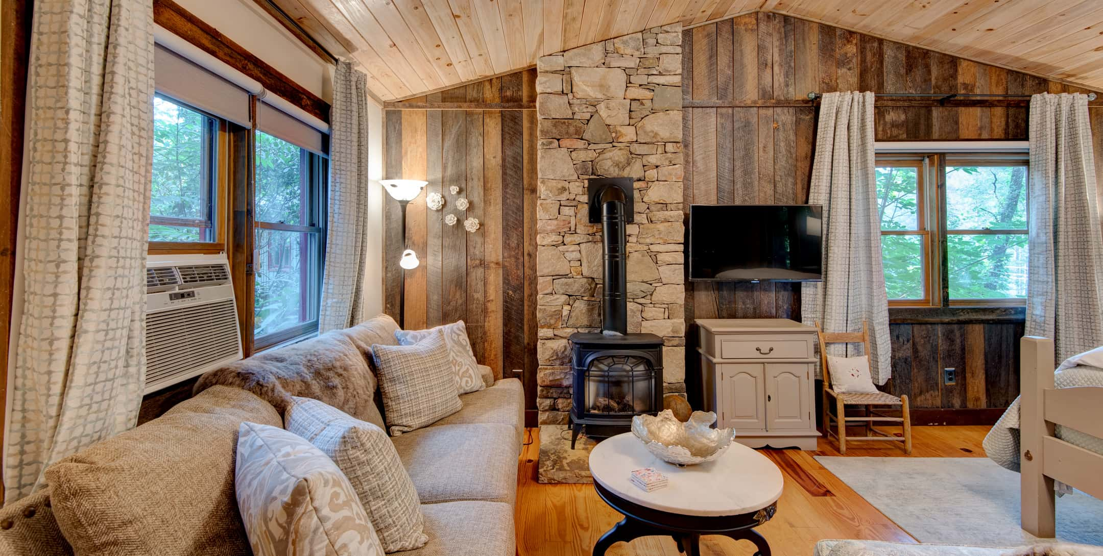 Inviting living room in the Gazebo Cabin with a fireplace and flatscreen TV