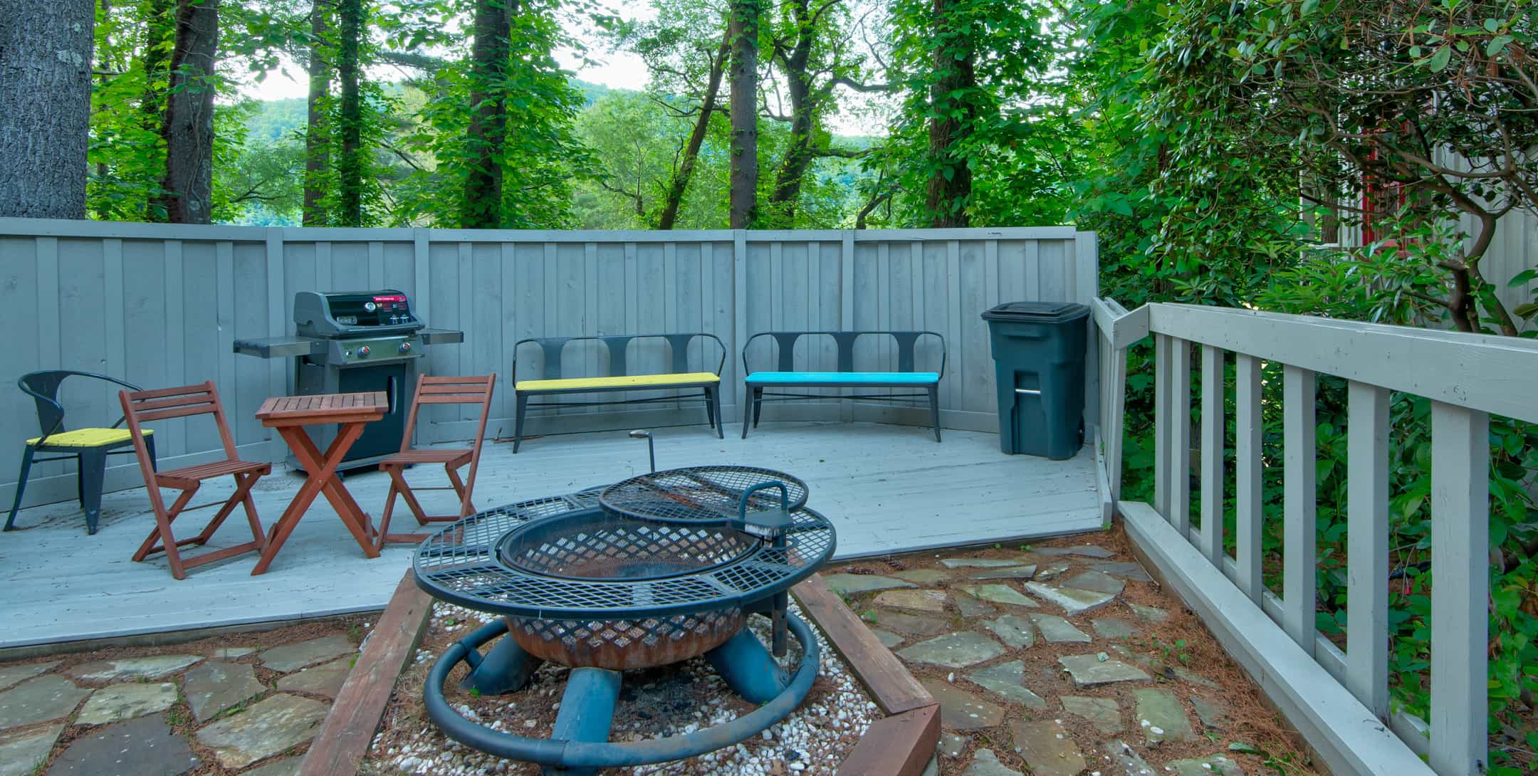 Back porch with firepit, grill, and chairs