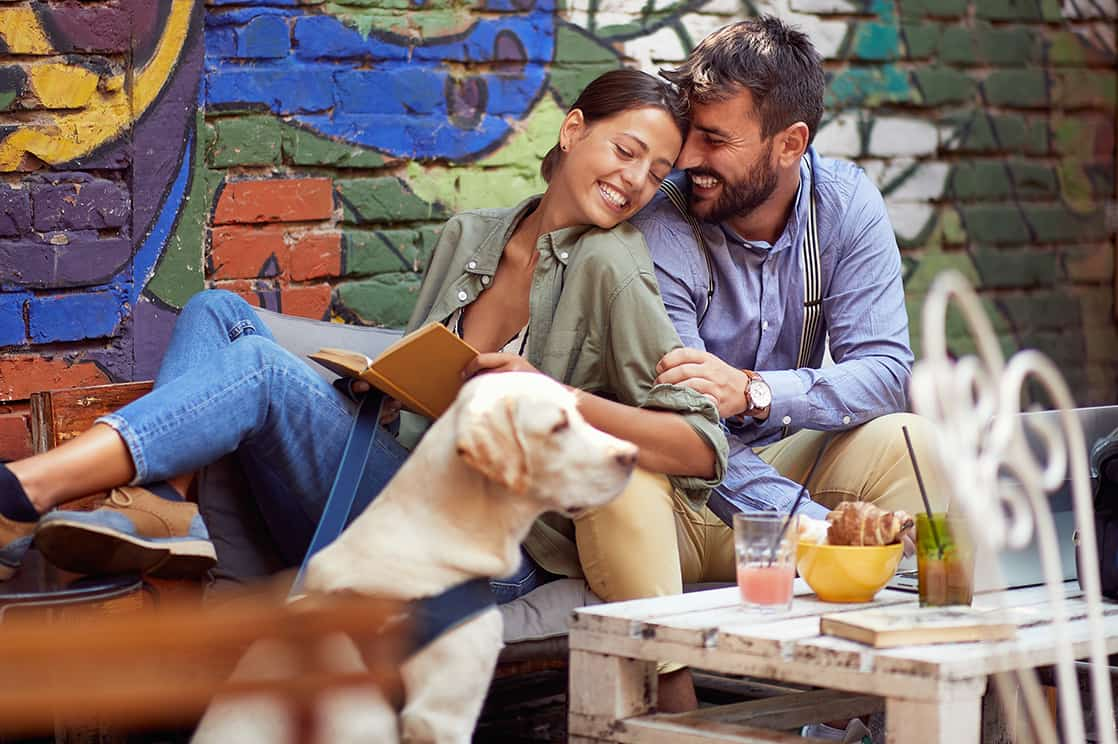 Couple dining with dog - pet friendly North Carolina cabins
