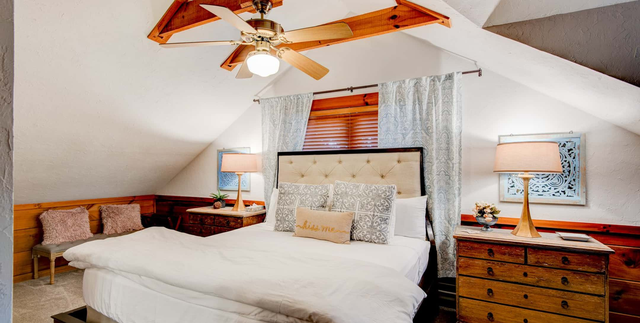 Bedroom in the Raspberry Hill cabin with a ceiling fan