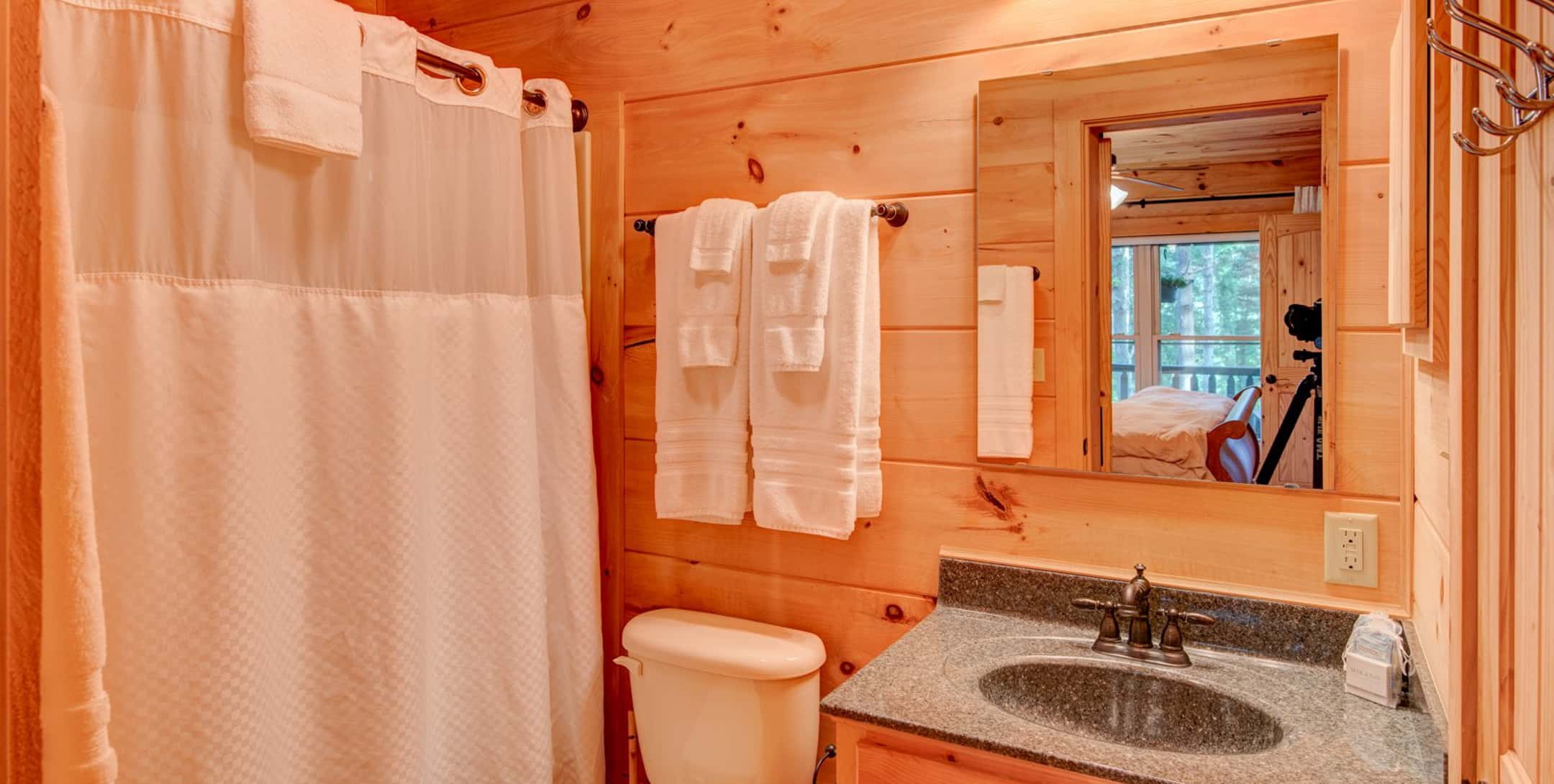Bath with a tub/shower combo in the Uncle Earl Cabin