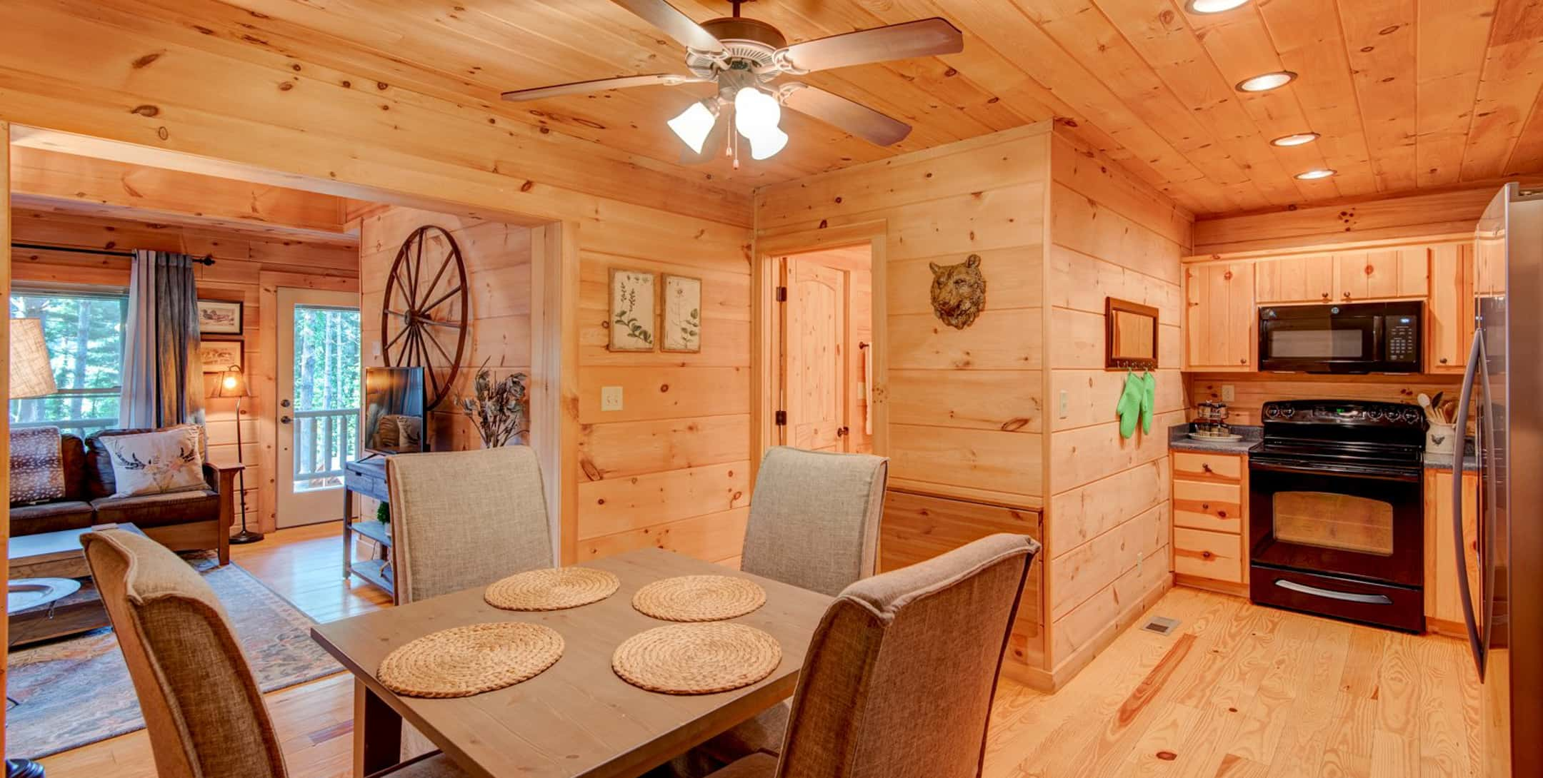 Dining table and kitchen in the Uncle Earl Cabin