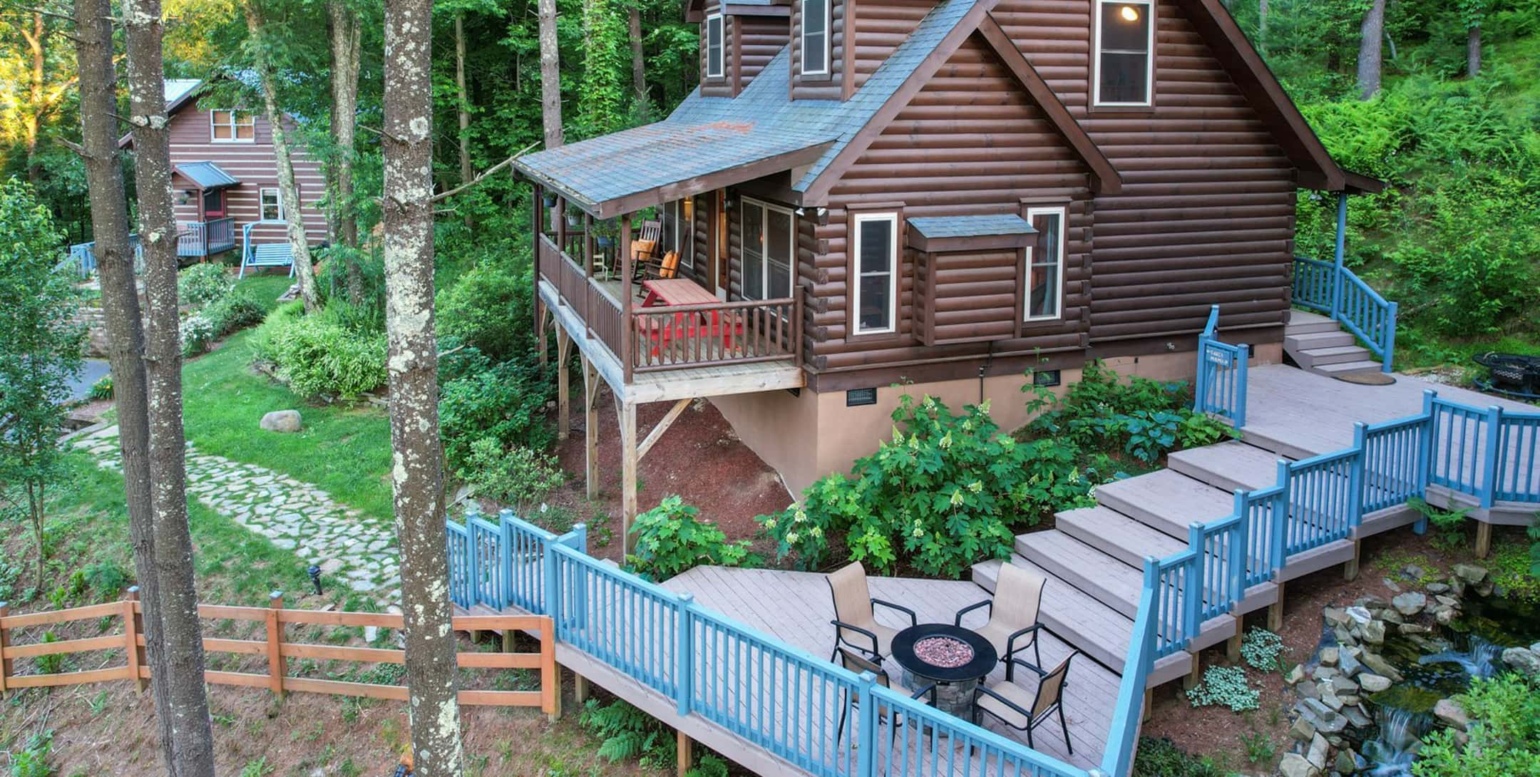 Uncle Earl Cabin exterior with large deck and firepit