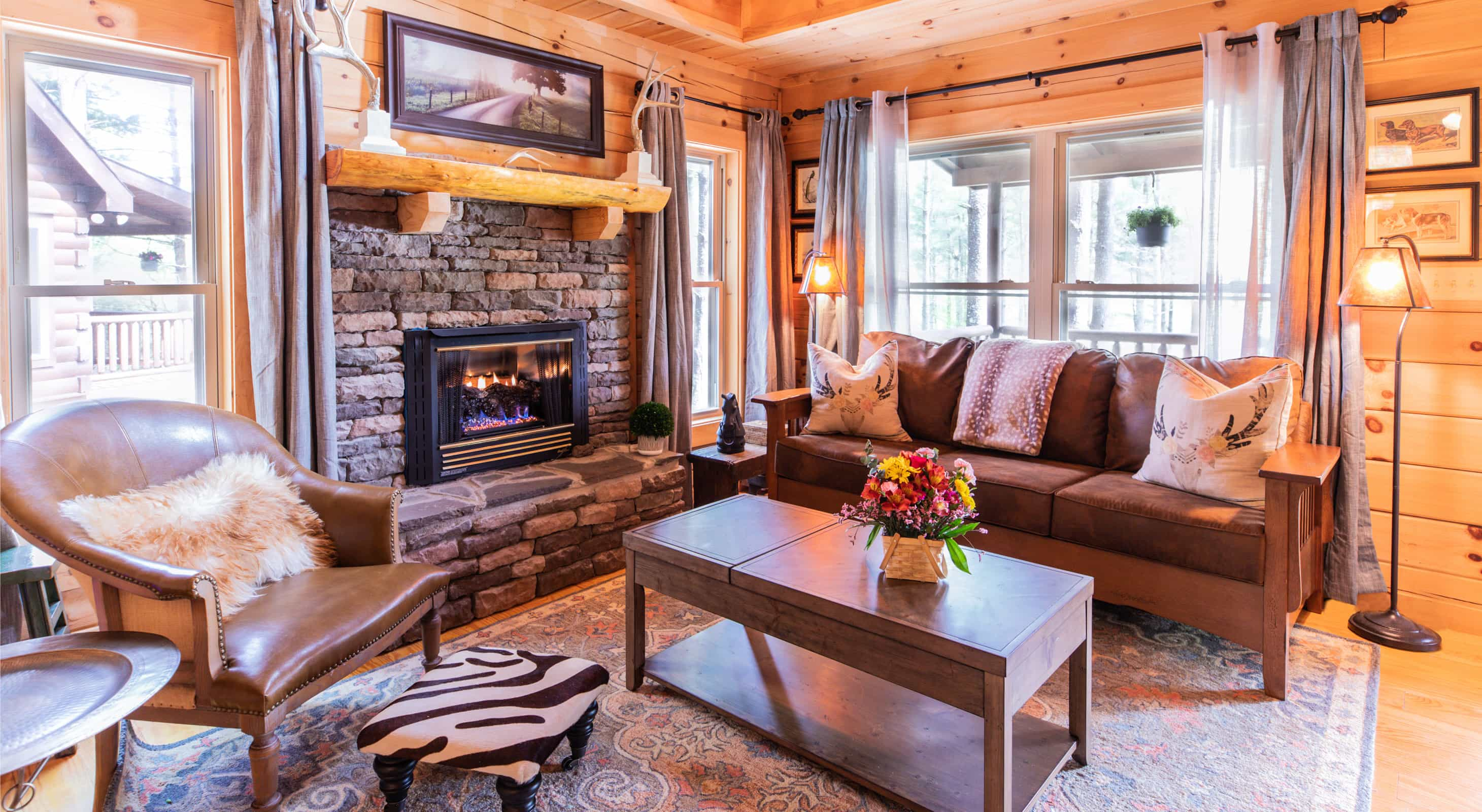 Spacious living room in Uncle Earl's cabin with a fireplace and couch
