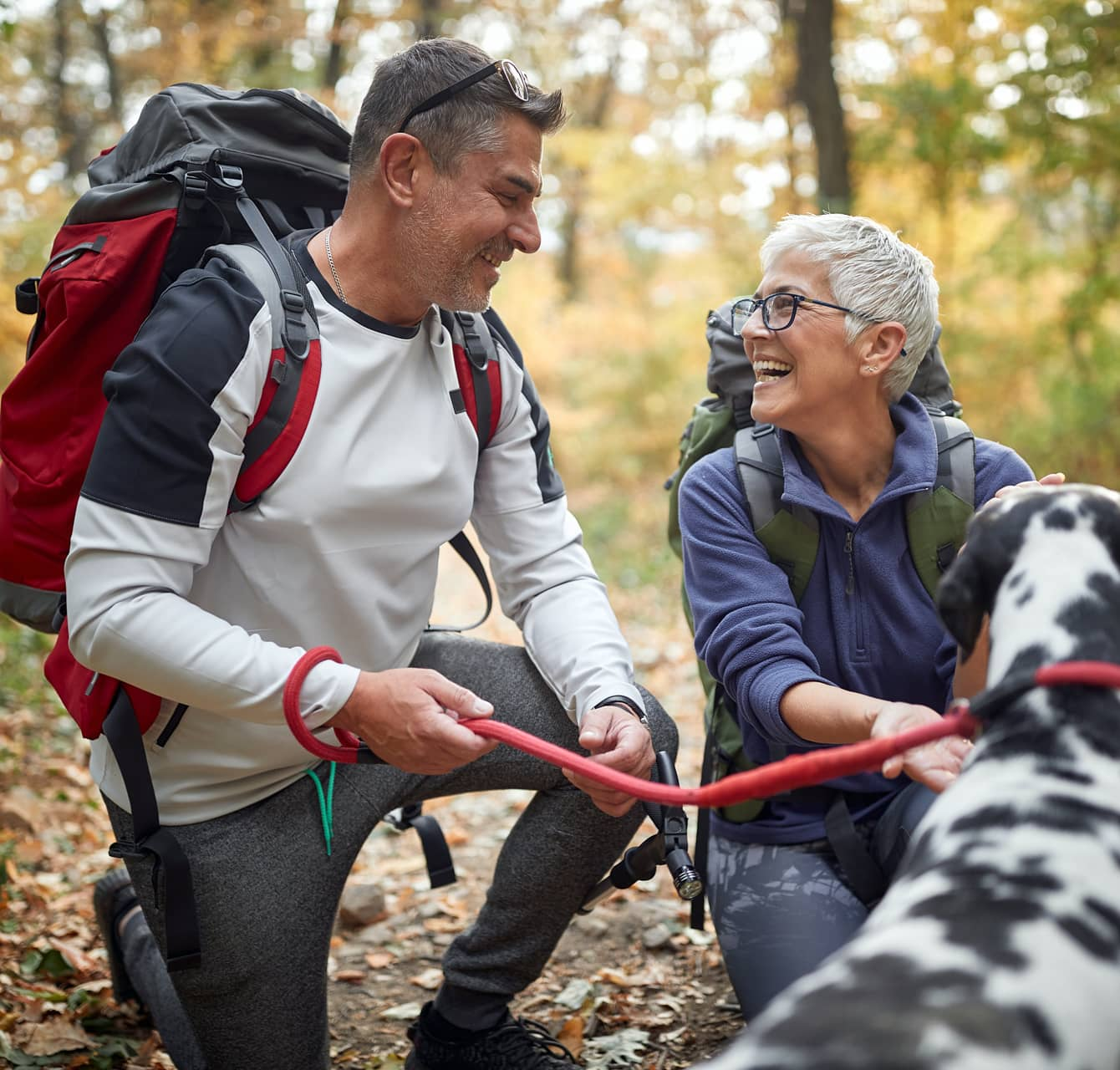Older couple hiking with their dog in North Carolina